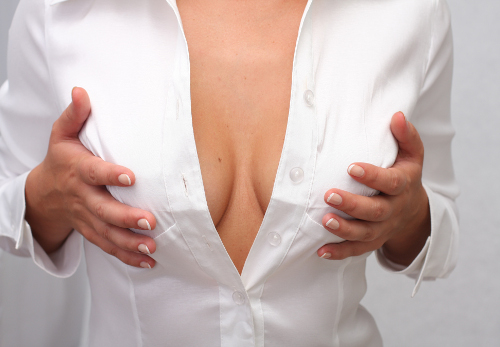 Young Woman Holding Breasts