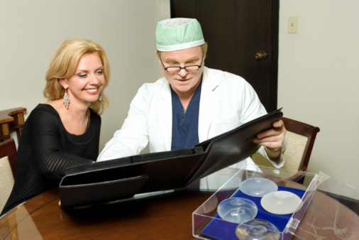 Doctor discussing breast augmentation
